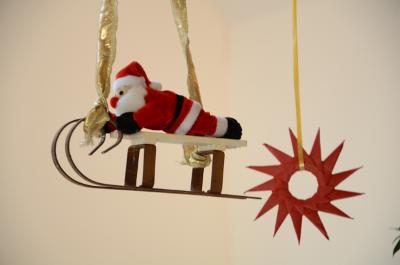 Weihnachtsmann auf Schlitte